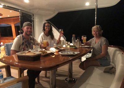 Stern deck dinner aboard Hilton Head Yacht Charter's Top Shelf